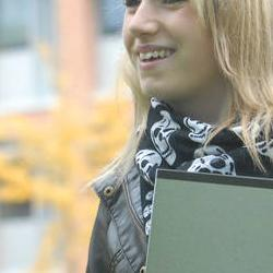 girl smiling with folder