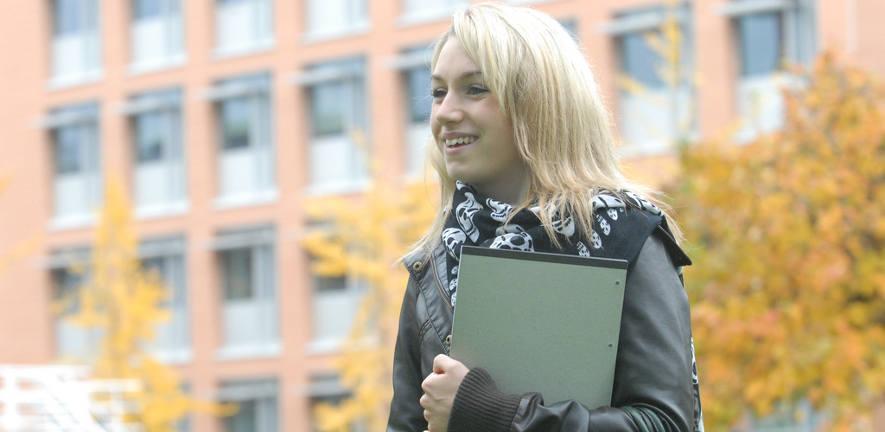 girl smiling with folder